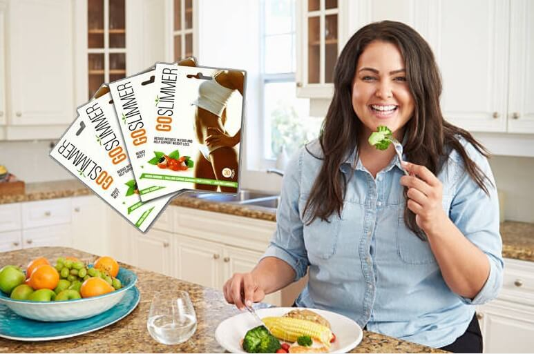 goslimmer, donna che mangia le verdure in cucina