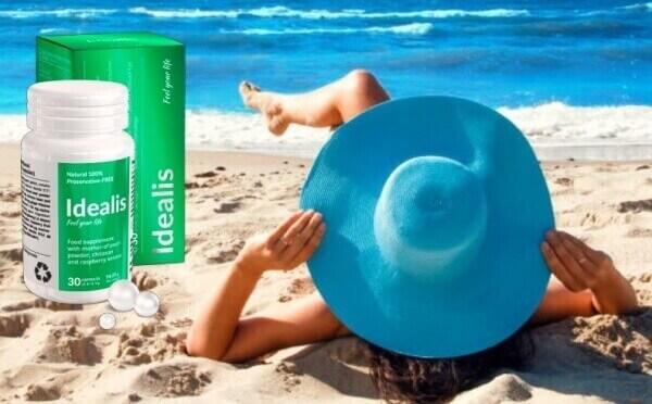 Idealis, donna sulla spiaggia con cappello
