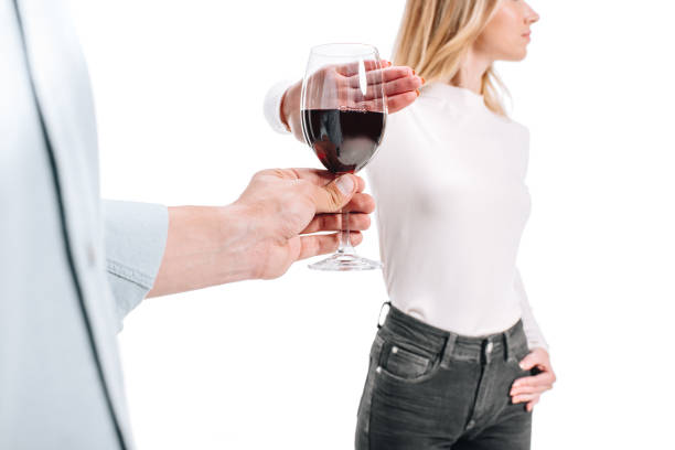 Donna, un bicchiere di alcol, seno